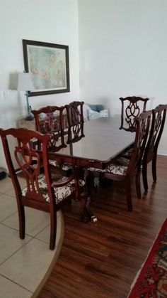Used (normal wear) - Cherry wood dining room table with 6 chairs.