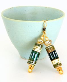 These have Christmas written all over them!! A year-round design but it seems so suited to Christmas. Green and Ivory Tribal Bead Earrings. Artisan by wildwomanbeads