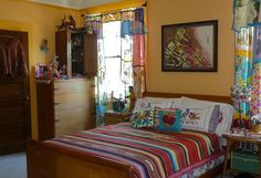 Mexican decor in bedroom.  <3 the gold walls...  maybe a living room color?