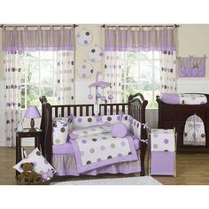This polka dot themed nine piece baby bedding set was created by Sweet Jojo Designs. This set includes a blanket, crib bumper, crib skirt, fitted sheet, toy bag, decorative throw pillow, diaper stacker, and two window valances.