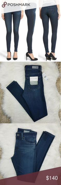 "AG // The Farrah High Rise Skinny Jeans in Crater Brand new with original tags!  Ag Adriano Goldschmied The Farrah High Rise Skinny Jean Contour 360 Memory Stretch Size 24 Wash: Crater Retail Value $205  Figure-flaunting skinny jeans are cut with a flattering high waist and cast in a deep-indigo wash that transitions flawlessly from day to night. Subtle whiskering and fading lend just a hint of worn-in appeal to this versatile style.  Inseam: 29"" Rise: 9"" Waist: 12.5"" flat across  85%…"