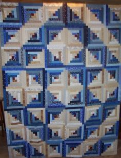 I have always wanted a log cabin quilt, and I love the look of a star in the middle. This is done in Blue, and Beige Scraps