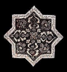 Museum number  G.452 Description  Full: Front  Tile (star). Quránic inscription around edge,part of the Imam Zade Yahya,Veramin group. Made of lustre glazed ceramic, pottery (white).
