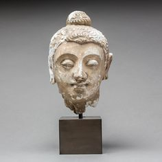 "Gandharan Stucco Buddha Head - AM.0216 Origin: Central Asia Circa: 100 AD to 300 AD  Dimensions: 7.5"" (19.1cm) high  Collection: Asian Art Medium: Stucco  £4,000.00  Location: Great Britain"