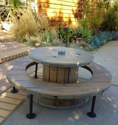 Outdoor table with bench