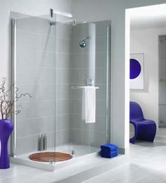 'Smoke' Grey glass 4x12 tile in shower: Found at https://www.subwaytileoutlet.com/