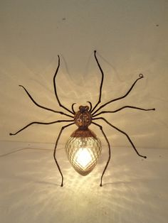 spider wall light - brass iron and glass insect light, about cm/ 20 in. can stand or sit.insect light, about cm/ 20 in. can stand or sit. Spider Light, Spider Lamp, Diy Lampe, Gothic House, Home And Deco, Wire Art, Cool Lighting, Lampshades, Chandeliers
