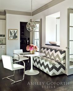 {I love the juxtaposition of the more traditional kitchen with the modern, graphic art and the modern furniture in the breakfast area.}     14 {The tulip table, Flat Bar Brno Chairs, and custom chevron banquette are so fun!}