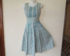 Hey, I found this really awesome Etsy listing at https://www.etsy.com/listing/215838145/vintage-50s-dress-cotton-aqua-turquoise