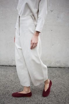 Sleek front really helps wide leg not feel too frumpy, so does hem just above ankle paired with cute slip ons. You can see slim ankle and slender foot off-setting wide leg. Same goes for converse, fit slim. Though, honestly, would be really fun to pair them with chunky ankle boot.