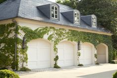 Beautiful carraige house style garage doors! Doesn't the landscaping just make it all pop? Portfolios - Dering Hall