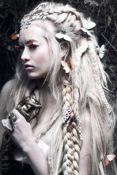 Braids, dreadlocks and butterflies created by hair stylist Niky Epifanio