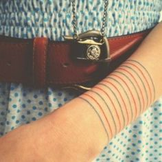 Get a set of blue and red notebook lines. | 32 Cool And Colorful Tattoos That Will Inspire You To Get Inked