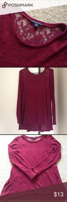 Maroon sweater Maroon sweater with lace back from American Eagle. Size small, but has a looser fit. In GUC, worn only a handful of times. Very cute. American Eagle Outfitters Tops Blouses