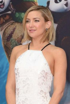 Kate Hudson looked stunning and gorgeous in a white oriental style dress with halterneck and subtle floral embroidery as she posed for the photographs on the red carpet at the premiere of Kung Fu Panda 3 on March 2, 2016 at the Zoo Palast Theatre in Berlin, Germany. On the red carpet, she was joined by her co-star Jack Black.