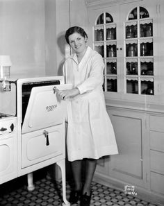 Green County 4-H Club girl, Helen Haldeman of Monroe, poses in the Madison Gas and Electric Co. demonstration kitchen, while she competes in the state cherry pie baking contest (1932).