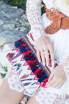 Tribal-inspired embroidered clutch with colorful tassels