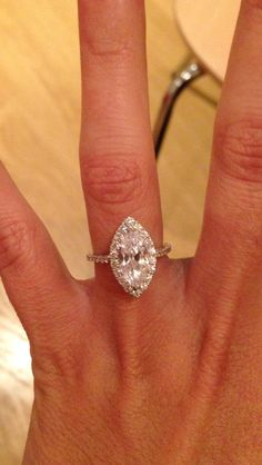 My custom made platinum and diamond marquise halo engagement ring :) xx