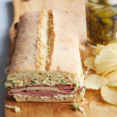 Pastrami & Slaw pressed sandwich from Midwest Living Sandwich Recipes, Lunch Recipes, Summer Recipes, Sandwich Ideas, Pressed Sandwich, Cold Sandwiches, Gourmet Sandwiches, Coleslaw Mix, Recipes