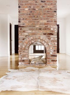 "I have dreamed of a 2-sided fireplace!  From ""A Minimalist Nashville Abode Home to a Textile Designer"" via Design*Sponge"