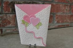 Here is a Valentine card made with the Cricut Wild Card cartridge (Wave page 50).  I made the card from cream colored cardstock and then cut...