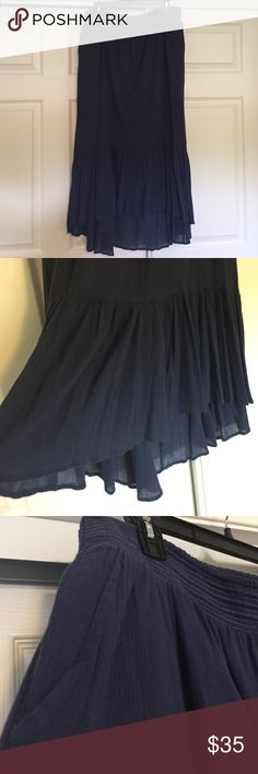 "Anthro navy midi skirt with pockets GUC Navy midi hi low skirt with pockets. Smocked waist measure 16"" unstretched.  30"" long in front and 36"" long in back. Ruffled hem, feels very Spanish style. Great closet staple! Best fits L or XL. By Anthro brand Edme & Esylite. No low ball offers. No modeling. Posh rules only. Thanks! Anthropologie Skirts High Low"