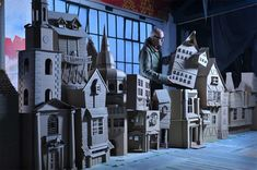 Dickensian street, built of cardboard by set designer, Simon Costin for the Museum of London.
