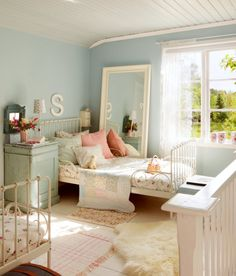 A little girl's bedroom with blue walls and pink and white accents.  Good design doesn't date!  Baronessa Home Furnishings and Accessories boasts a beautiful online showroom, which is a combination of custom made, vintage, and antique luxury home furnishings and accessories. Visit our website at www.ShopBaronessa.com.