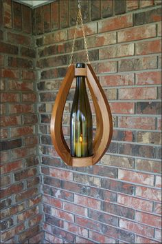 "Handcrafted Hanging Wine Bottle Candle Lantern w/ Wooden Basket, Wine Bottle Decor, Wine Bar Decor, Wine Lovers Gift, Porch Lighting, by WoodsmithOfNaples, $50.00 EACH CANDLEHOLDER VARIES SLIGHTLY IN DIMENSION. Height: 12 1/2"" (+/-). Hanging Brass Chain adds 7 1/2"" (+/-). Width: 9 3/4"" (+/-)."