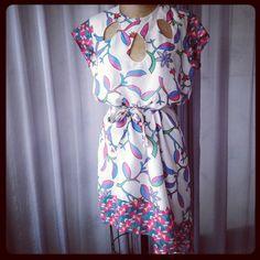 Vestido de algodón asimétrico con cut-outs  $175.000