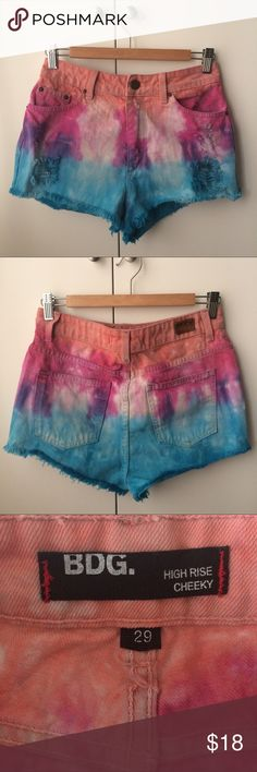 BDG High Rise Cheeky Tie Dye Shorts Awesome little high rise tie dye shorts by BDG for Urban Outfitters. Bought from another Posher, in good condition. There are a few dark marks throughout the fabric that I'm not sure are original tie dye or if they are stains. Not too noticeable but please see the photos. True to size, maybe a little snug. Thanks for looking, feel free to ask questions and offers are always welcome! 20% off bundles of 2 or more ✌️💗😊 Urban Outfitters Shorts Jean Shorts