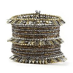 Add a little flare to your gown by pairing it with this metallic cuff from Claire's $12.50