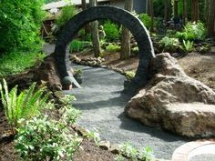 Stargate yard arch. Nice. I need an arch...I need a house, then I need an arch...