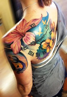 Clock and lily tattoo