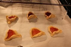 PURIM: Hamentashen (Jewish Cookies) filled with fruit. They are made in the shape of Haman's hat. Who's Haman? Read the story of Hadassah (Esther) to find out!