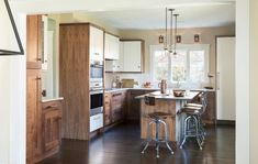 White-and-Walnut Kitchen Cabinets Steal the Show Kitchen Backsplash, Backsplash Ideas, Tile Ideas, Walnut Kitchen Cabinets, Small Kitchen Redo, Tile Layout, Kitchen Trends, Home Kitchens, Kitchen Design