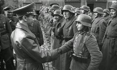 Joseph Goebbels awards 16-year old Hitler Youth member Willi Hübner the Iron Cross for the defense of Lauban.  March 9, 1945.