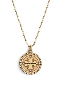 Made from antiqued brass, this Tory Burch necklace adds a vintage charm to the jewelry collection.