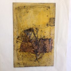 A collograph plate is made by gluing objects & textures to a dense card base. This is then varnished with shellac on both sides to waterproof it. Once dry it can be inked up for printing.