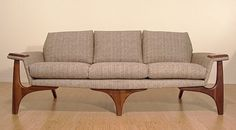 Danish sofa.  Cool looking but not very comfortable... I remember them from when I was young....