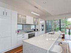 Modern island kitchen design using floorboards - Kitchen Photo 115282