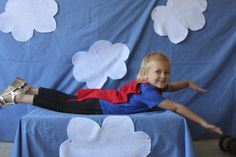 "I set up a ""photobooth"" for the kids to pretend they were superheroes flying through the sky."