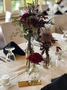 Grouping of Glass Bottles for Centerpiece- Chocolate Queen Anne's Lace, Red Roses, Agonis and a Eucalyptus. Bottle Centerpieces, Wedding Table Centerpieces, Floral Centerpieces, Wedding Decorations, Red Rose Wedding, Floral Wedding, Wedding Flowers, Fall Wedding, Wedding Ideas