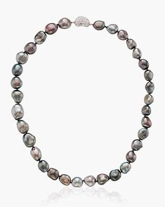 Elsa Peretti gray cultured pearl and diamond 'Bean' necklace. A single strand of gray baroque cultured pearls with a diamond clasp.