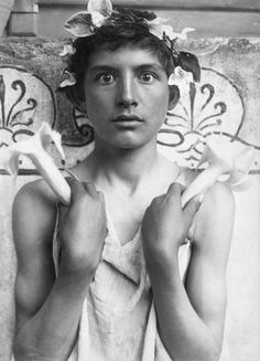Wilhelm von Gloeden :: Hypnos, Taormina, Sicily, 1900′s [Hypnos, 'Sleep' in Greek, comes from the fact that the boy holds two flowers of Brugmansia having a hypnotic effect]