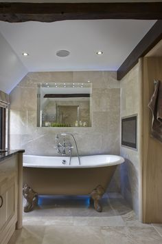 The entrance to the en-suite bathroom is encompassed within the line of beautiful wardrobes, you don't realise it is there until you open one of the doors. Vaulted Ceiling Bedroom, Bespoke Kitchens, Bathroom Furniture, Surrey, Luxury Interior, Corner Bathtub, Beams, Beautiful Homes, Architecture