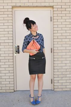 I like everything about this outfit: the polka dots, the jeweled necklace under the collar, the zippered skirt, the clutch. Love it all.