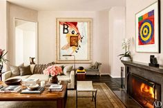 Artworks by Julian Schnabel (left) and Jasper Johns overlook the living room in a Beverly Hills home.