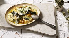 Soft polenta, fried eggs, sage, capers and parmesan