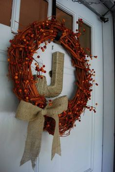 Great idea. Spray paint grapevine wreath orange. Cover with vines of orange berries. Burlap bow. Burlap letter should be on the wreath.